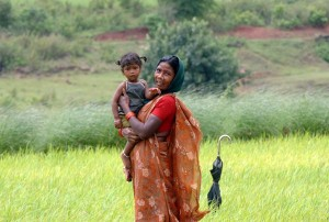 Bright Eyes Mother And Child In A Rice Field