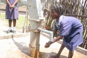 These schoolchildren in Zambia enjoy access to fresh water, thanks to our generous donors! Photo by Wairimu Gitahi.