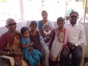 With his mother, wife and four daughters at his side, Kandi Chandramohan beams as he and his mother recover from cataract surgery.
