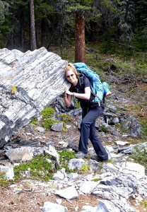 Jennifer attempts to lift a boulder during their overnight hike in Kananaskis, AB earlier this month.