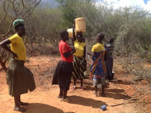 Along with other village women, Ann discusses best options for water gathering.