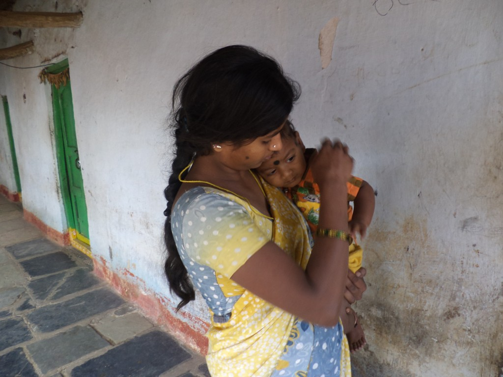 Laxmi holds her son, Anil, who was born with bilateral cataracts.