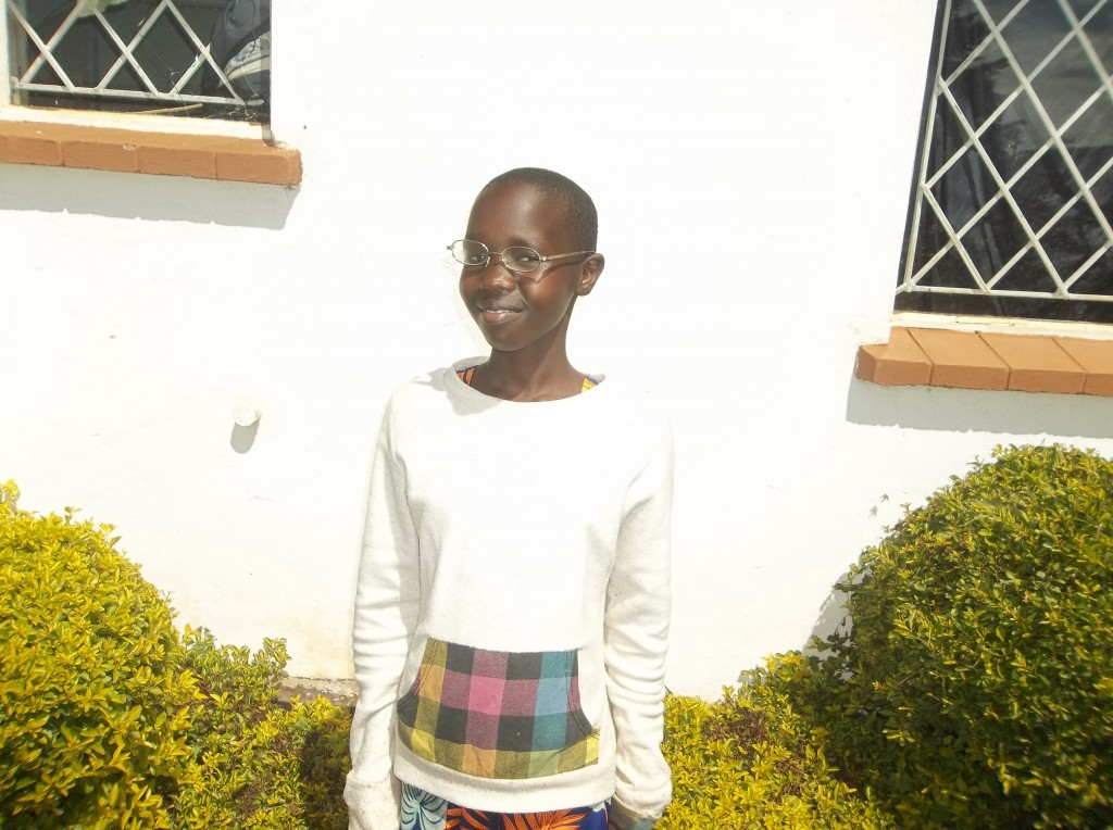 Mercy is grateful for her new custom-fitted, prescription eyeglasses