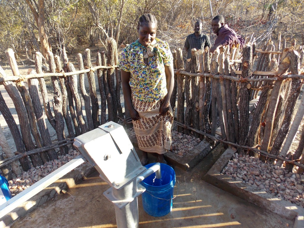 Evalina fetches water from the borehole provided by Operation Eyesight.