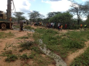 Local villagers watch a borehole being drilled in West Pokot district. Because water is so precious, we work with communities so that they raise the funds to maintain the borehole equipment and manage this valuable resource in the long-term.