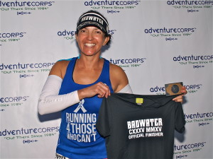 Norma poses with the coveted Badwater® belt buckle and t-shirt. Way to go, Norma! [Photo by Chris Kostman/Badwater.com]