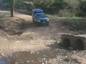 Even sturdy 4x4 vehicles, like this Operation Eyesight vehicle at a washed out road in Kenya's Narok District, may only last a few years in these road conditions!