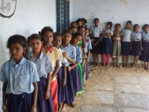 Children line up to have their vision tested.