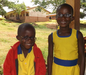Michael and Priscilla show off their new prescription eyeglasses – thanks to our donors' support!